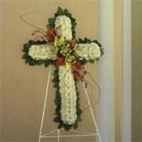 White Cushion Poms, Green Cymbidium Orchids & Red Novelty Orchids Standing Cross by McAdams Floral, Victoria|Cuero|Goliad|Edna|Port Lavaca, Texas (TX)  Funeral Florist